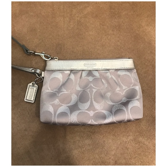 Coach Handbags - ‼️4 for $25‼️ Coach silver Wristlet